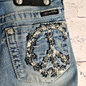 MISS ME Embellished Peace Sign Flare Jeans